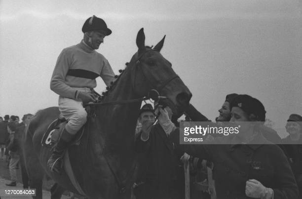 Anne Grosvenor Duchess of Westminster congratulates Irish jockey Pat Taaffe on her racehorse Arkle after they won the Gold Cup at Cheltenham Races UK...