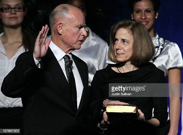Anne Gust Brown looks on as her husband Jerry Brown is sworn in as the 39th governor of California by California on January 3 2011 in Sacramento...
