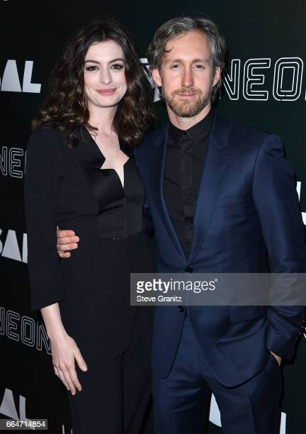 Anne Hathaway Adam Shulman arrives at the Premiere Of Neon's 'Colossal' at the Vista Theatre on April 4 2017 in Los Angeles California