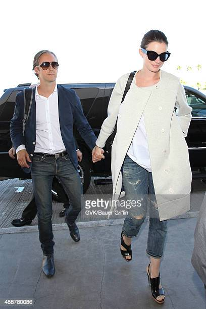 Anne Hathaway and Adam Shulman are seen at LAX on September 17 2015 in Los Angeles California