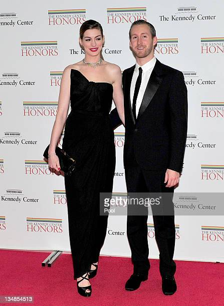 Anne Hathaway and Adam Shulman arrive for the formal Artist's Dinner honoring the recipients of the 2011 Kennedy Center Honors hosted by United...