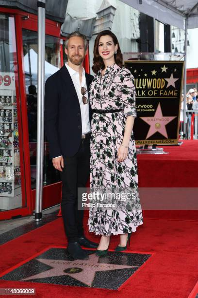 Anne Hathaway and Adam Shulman attend a ceremony honoring Anne Hathaway with a star on The Hollywood Walk of Fame on May 09 2019 in Hollywood...