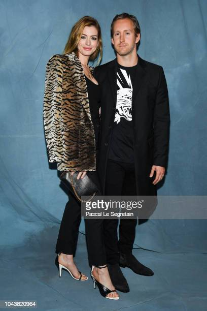 Anne Hathaway and Adam Shulman attend the Givenchy show as part of the Paris Fashion Week Womenswear Spring/Summer 2019 on September 30 2018 in Paris...