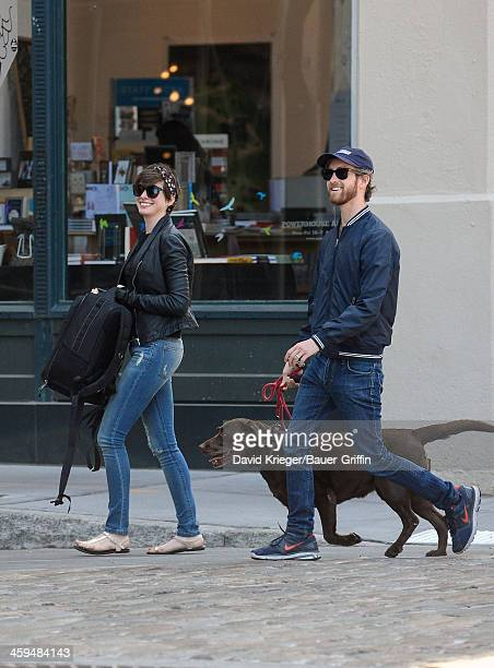 Anne Hathaway and Adam Shulman with their dog Esmeralda are seen on May 04 2013 in New York City