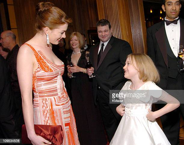Anne Hathaway and Dakota Fanning during Entertainment Industry Foundation's Colon Cancer Benefit on the QM2 VIP Cocktail Hour at Queen Mary 2 in New...