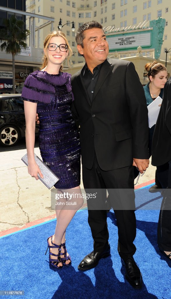 Anne Hathaway and George Lopez arrive for the premiere of Twentieth Century Fox & Blue Sky Studios' 'RIO' on April 10, 2011 in Hollywood, California.