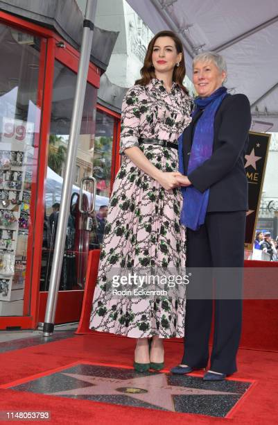 Anne Hathaway and her mother Kate McCauley Hathaway pose for portrait at Anne Hathaway Honored With Star On The Hollywood Walk Of Fame on May 09 2019...