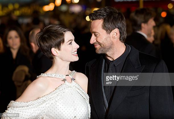 Anne Hathaway and Hugh Jackman pose for photographers on the red carpet ahead of the world premiere of 'Les Miserables' in central London on December...