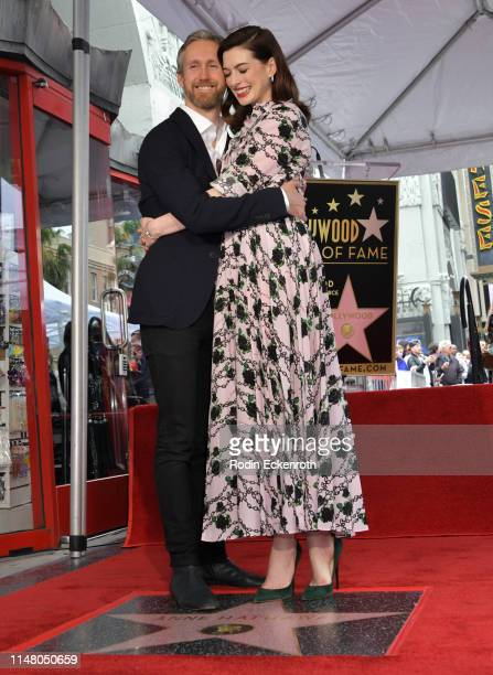 Anne Hathaway and husband Adam Shulman pose for portrait at Anne Hathaway Star Ceremony On The Hollywood Walk Of Fame on May 09, 2019 in Hollywood,...