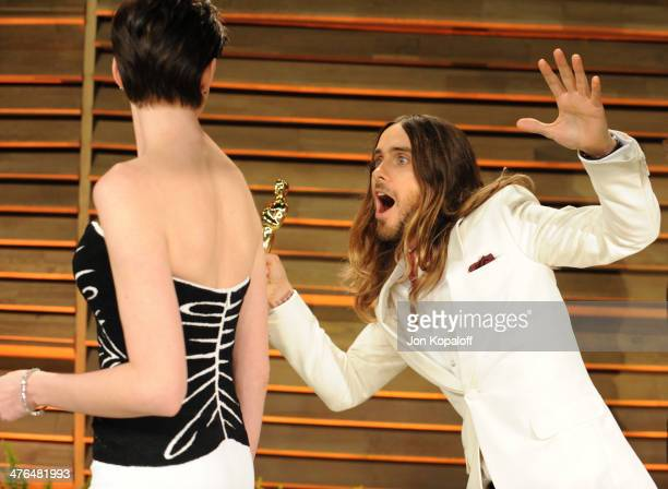 Anne Hathaway and Jared Leto attend the 2014 Vanity Fair Oscar Party hosted by Graydon Carter on March 2 2014 in West Hollywood California