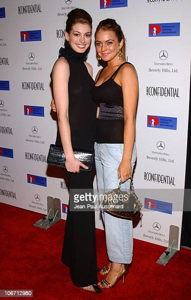 Anne Hathaway and Lindsay Lohan during Anne Hathaway Oliver Hudson and Anson Mount Host Fundraiser for Defense for Children International Hosted by...