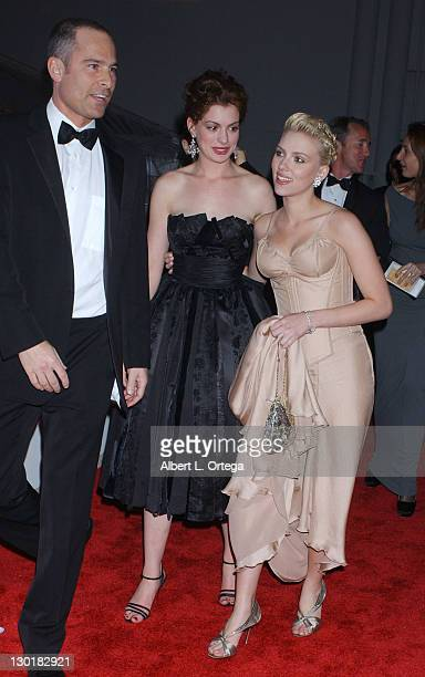 Anne Hathaway and Scarlett Johansson during Miramax Glamour Golden Globe After Party Arrivals at Trader Vics in Beverly Hills California United States