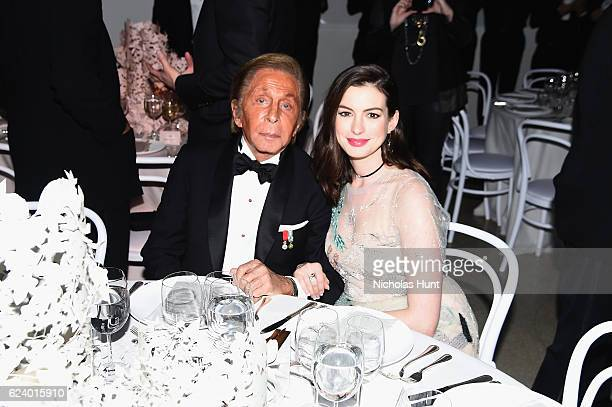 Anne Hathaway and Valentino Garavani attend the 2016 Guggenheim International Gala Made Possible By Dior at Solomon R Guggenheim Museum on November...