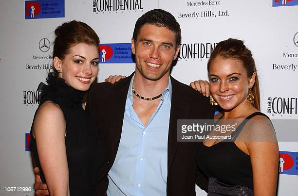 Anne Hathaway Anson Mount and Lindsay Lohan during Anne Hathaway Oliver Hudson and Anson Mount Host Fundraiser for Defense for Children International...