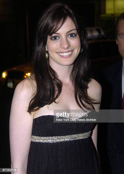 Anne Hathaway arrives at the St Regis Hotel for an auction benefiting The Breast Cancer Research Foundation Dress for Success and Equality Now after...