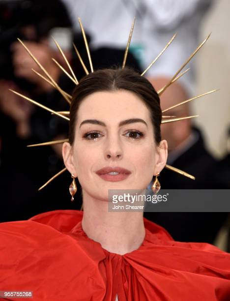 Anne Hathaway attends the Heavenly Bodies Fashion The Catholic Imagination Costume Institute Gala at The Metropolitan Museum of Art on May 7 2018 in...