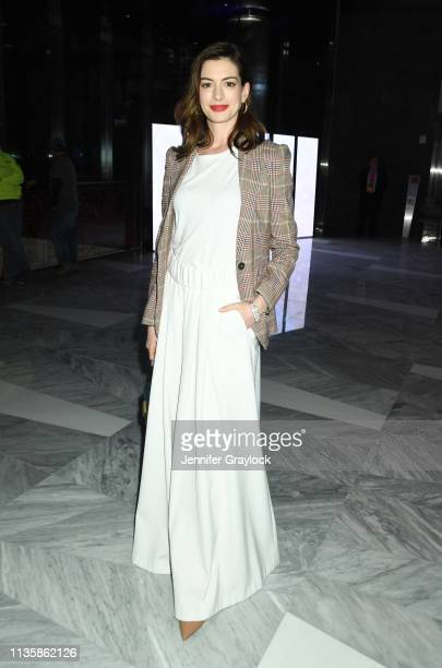 Anne Hathaway attends the Watches Of Switzerland Hudson Yards opening on March 14, 2019 at Hudson Yards in New York City.