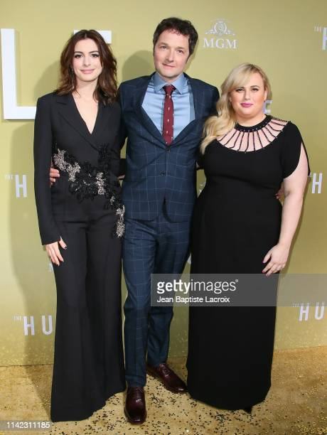 Anne Hathaway Chris Addison and Rebel Wilson attend the premiere of MGM's The Hustle at ArcLight Cinerama Dome on May 08 2019 in Hollywood California