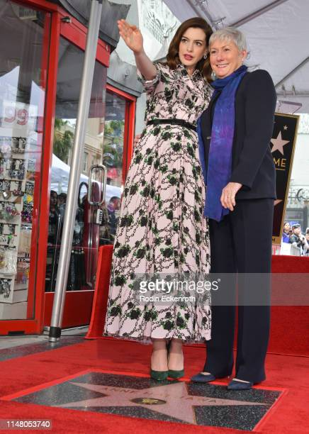 Anne Hathaway directs the eye line of her mother Kate McCauley Hathaway while being honored with a star on The Hollywood Walk of Fame on May 09 2019...