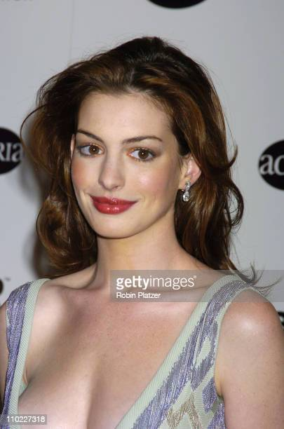 Anne Hathaway during amfAR and ACRIA Honor Herb Ritts with a Sale of Contemporary Artwork Arrivals at Sothebys in New York New York United States