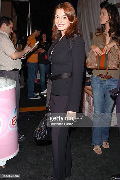 Anne Hathaway during Olympus Fashion Week Spring 2005 Luca Luca Front Row and Backstage at Theater Tent Bryant Park in New York City New York United...