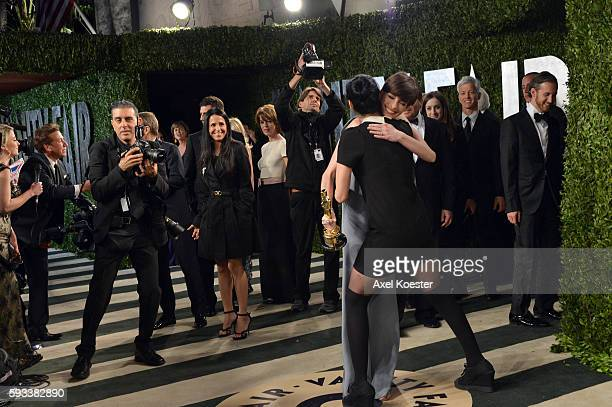 Anne Hathaway greets Sarah Silverman as she arrives to the Vanity Fair after party of the 85th Academy Awards hosted by Graydon Carter at the Sunset...