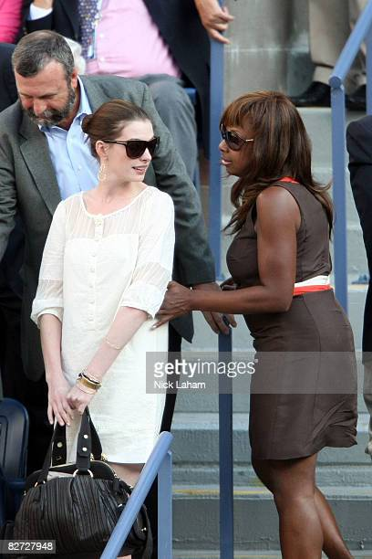 Anne Hathaway greets Star Jones at the 2008 US Open Men's Championship Match between Andy Murray of the United Kingdom and Roger Federer of...