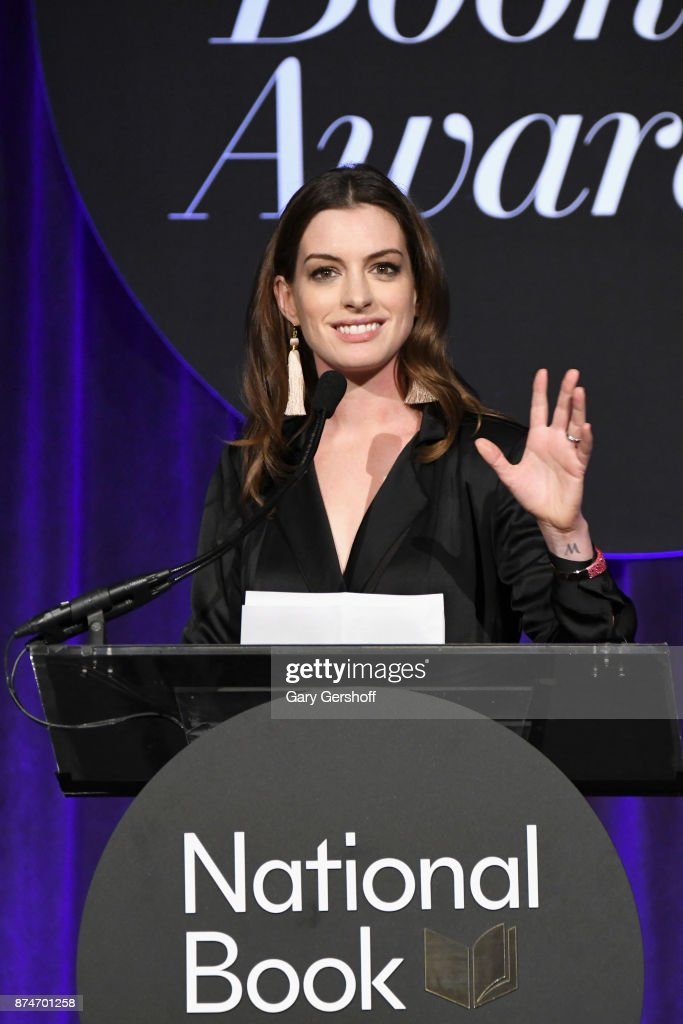 Anne Hathaway introduces event honoree Annie Proulx during the 68th National Book Awards at Cipriani Wall Street on November 15, 2017 in New York City.