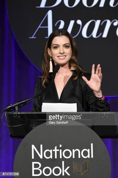 Anne Hathaway introduces event honoree Annie Proulx during the 68th National Book Awards at Cipriani Wall Street on November 15, 2017 in New York...
