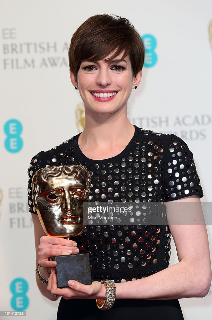 Anne Hathaway poses in the Press Room at the EE British Academy Film Awards at The Royal Opera House on February 10, 2013 in London, England.