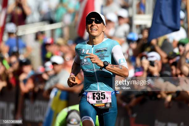 Anne Haug of Germany celebrates after finishing third during the IRONMAN World Championships brought to you by Amazon on October 13 2018 in Kailua...