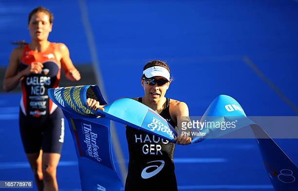 Anne Haug of Germany celebrates her win in the Barfoot Thompson ITU World Triathlon Women's Race on April 6 2013 in Auckland New Zealand