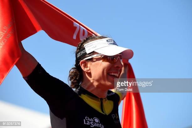 Anne Haug of Germany celebrates winning the Ironman 703 Dubai 2018 on February 2 2018 in Dubai United Arab Emirates