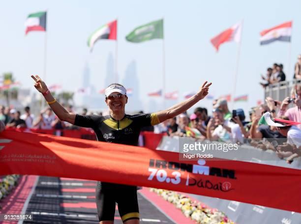 Anne Haug of Germany celebrates winning the women's race Ironman 703 Dubai on February 2 2018 in Dubai United Arab Emirates