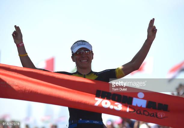 Anne Haug of Germany crosses the fininsh line to win the Ironman 703 Dubai 2018 on February 2 2018 in Dubai United Arab Emirates