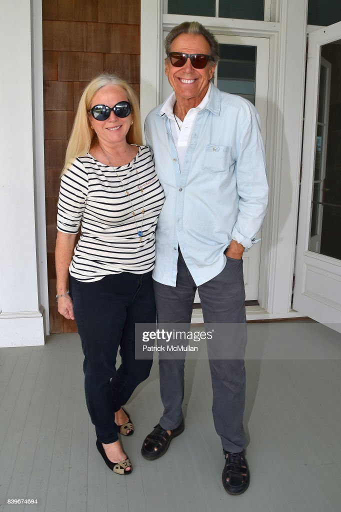 Anne Hearst McInerney and Bill Boggs attend Anne Hearst McInerney and Jay McInerney's celebration of Amanda Hearst and Hassan Pierre's Maison de Mode at a Private Residence on August 26, 2017 in Water Mill, New York.