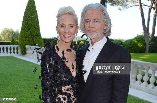 Anne Heche and Hermann Buehlbecker arrive at the amfAR Gala Cannes 2018 at Hotel du Cap-Eden-Roc on May 17, 2018 in Cap d'Antibes, France.