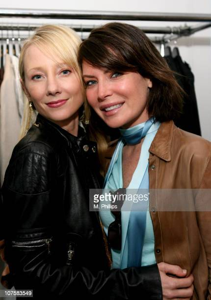 Anne Heche and Lara Flynn Boyle during GQ / Calvin Klein Celebrity Poker Tournament Benefiting Peace Games Calvin Klein Gift Lounge at Private...