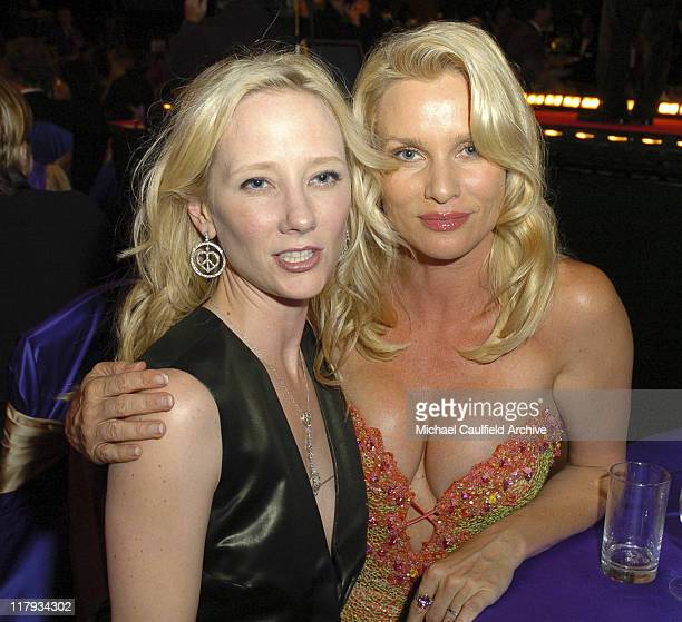 Anne Heche and Nicollette Sheridan during 12th Annual Race to Erase MS CoChaired by Tommy Hilfiger and Nancy Davis Backstage and Audience at The...