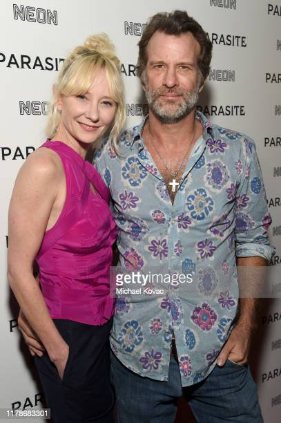 Anne Heche and Thomas Jane attend the Los Angeles Premiere of Parasite on October 02 2019 in Hollywood California