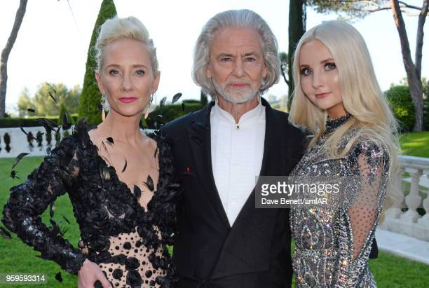 Anne Heche, Hermann Buehlbecker and Anna Hiltrop arrive at the amfAR Gala Cannes 2018 at Hotel du Cap-Eden-Roc on May 17, 2018 in Cap d'Antibes,...