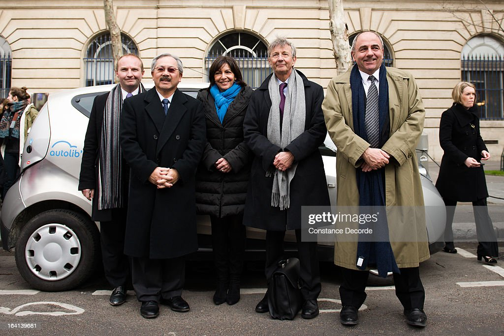 Anne Hidalgo and Cedric Bolloreas (2nd R) pose with others as San Francisco Mayor Ed Lee makes an official visit for the Autolib presentation, on March 20, 2013 in Paris, France.