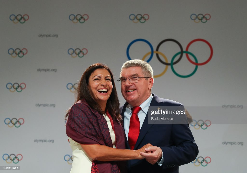 Anne Hidalgo and Thomas Bach laugh during a joint press conference between IOC, Paris 2024 and LA2028 during the131th IOC Session - 2024 & 2028 Olympics Hosts Announcement at Lima Convention Centre on September 13, 2017 in Lima, Peru.