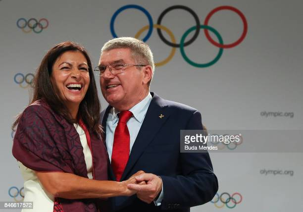 Anne Hidalgo and Thomas Bach laugh during a joint press conference between IOC Paris 2024 and LA2028 during the131th IOC Session 2024 2028 Olympics...