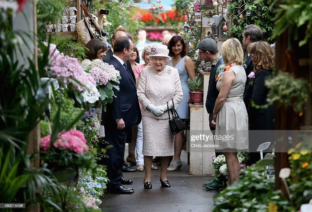 Anne Hidalgo Mayor of Paris (L) and Francois Hollande President of France walk behind Queen Elizabeth II as she visits Paris Flower Market on June 7, 2014 in Paris, France. Queen Elizabeth II and Prince Philip, Duke of Edinburgh are on the final day of a three day State Visit to Paris. The Flower Market was named 'Marche Aux Fleurs Reine Elizabeth II' in the Queen's Honour today.