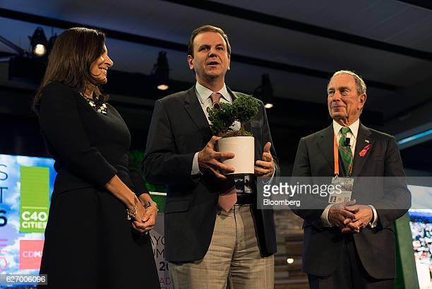 Anne Hidalgo, mayor of Paris, from left, Eduardo Paes, mayor of Rio de Janeiro, and Michael Bloomberg, founder of Bloomberg LP and former mayor of...