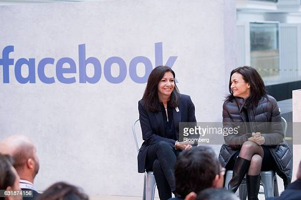 Anne Hidalgo mayor of Paris left and Sheryl Sandberg chief operating officer of Facebook Inc react during a news conference at Station F a megacampus...