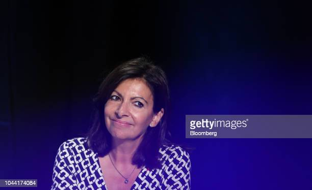 Anne Hidalgo mayor of Paris reacts during a panel discussion at the Tomorrow in Motion event ahead of the Paris Motor Show in Paris France on Monday...