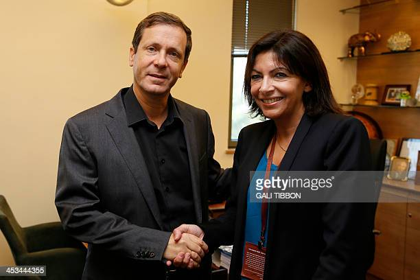 Anne Hidalgo Paris deputy mayor and Socialist Party candidate for the primary round of Paris municipal elections shakes hand with Israeli opposition...