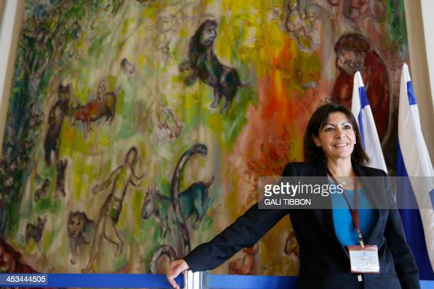 Anne Hidalgo Paris deputy mayor and Socialist Party candidate for the primary round of Paris municipal elections stands next to a tapestry made by...